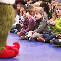 "Addison Metcalfe reacts as ""The Grinch"" visits ECEC on Monday ans tells his story about how he stole Christmas."