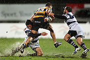 Ash Moeke and Jamie Helleur tackle Taranaki centre Paul Perez. <br /> Air New Zealand Cup rugby match - Taranaki v Auckland at Yarrows Stadium, New Plymouth, New Zealand. Friday 9 October 2009. Photo: Dave Lintott/PHOTOSPORT