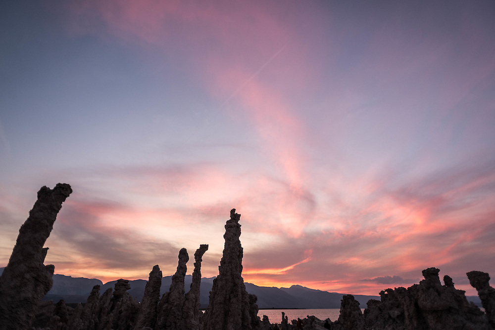 Last light of the day catches the clouds above South Tufa, Mono Lake