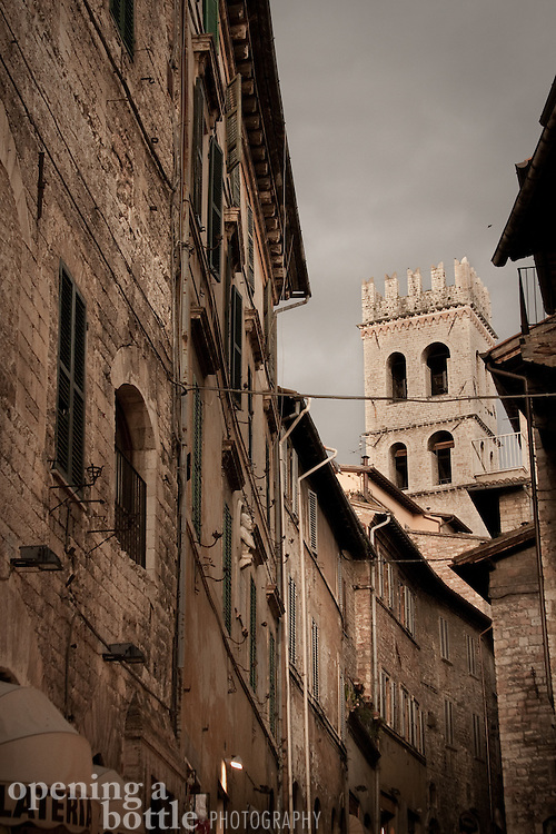 Streets and alleyways and the medieval bell tower over the Temple of Minerva in Assisi, Umbria, Tuscany. Full color version available. Contact via email to request.