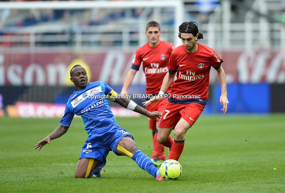 Javier Pastore (psg) - Eloge Yamissi (tro). Troyes v PSG at Stade de l'Aube, Paris Saint-Germain won 1-0, 13 April 2013. Photo: Anthony Bibard.
