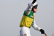 Jason Maquire on Ballabriggs gives a victory salute after crossing the finishing line as he wins the 2011 John Smith's Grand National.