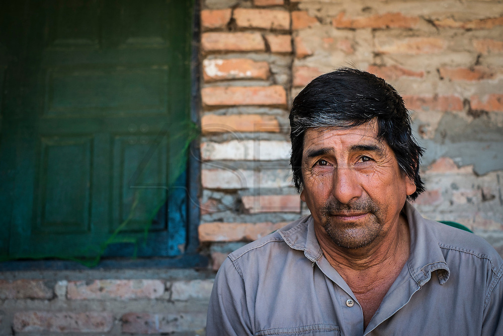 2014/11/23 – Quimili, Argentina: Raúl Eduardo Leal (56) in his house  during siesta time at the Guaycurú Indigenous Community of Bajo Hondo. He complains how the soy producers are deforestation the area around his community. The region around Quimili on the Santiago Estero Province is being vastly converted from forestland into fields to produce soy, detroying the habitats for local species and indigenous people. (Eduardo Leal)