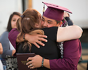 Cal Hills High School senior Bronson Cascayan hugs his mother Bridget Cascayan after the Class of 2013 graduation at the Milpitas Sports Center in Milpitas, California, on June 6, 2013. (Stan Olszewski/SOSKIphoto)