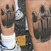 Tattoo on his leg.<br /> <br /> Body art or tattoos has entered the mainstream it is no longer considered a weird kind of subculture.<br /> <br /> &quot;According to a 2006 Pew survey, 40% of Americans between the ages of 26 and 40 have been tattooed&quot;.