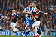 Brighton striker Tomer Hemed & Derby County midfielder Craig Bryson battle for possession during the Sky Bet Championship match between Brighton and Hove Albion and Derby County at the American Express Community Stadium, Brighton and Hove, England on 2 May 2016. Photo by Bennett Dean.
