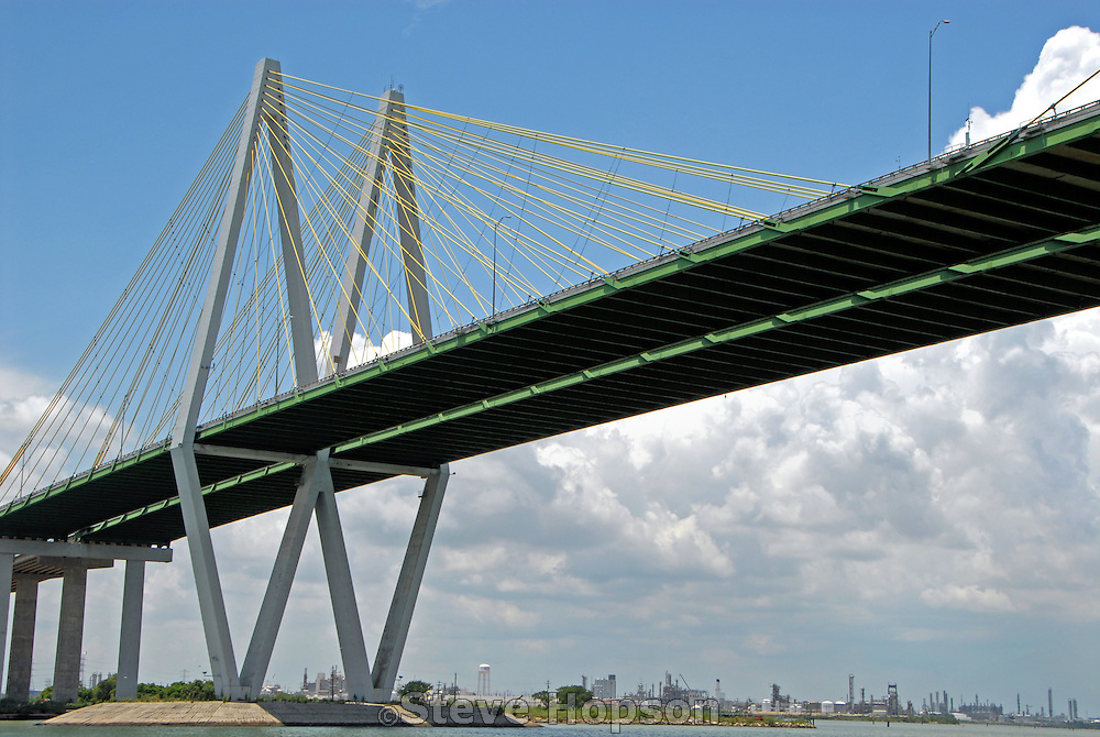The Fred Hartman Bridge connecting La Porte to Baytown Texas, July 7 2008. The bridge is Texas' longest cable-stayed bridge, spans the Houston Ship Channel, and carries State Highway 146. The Houston Ship Channel is part of the Port of Houston and one of U.S. busiest sea ports and the location of many petrochemical plants.