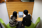 Tokyo -  June 2, 2010 - Konkatsu, the Japanese marriage Hunting. Onet matchmaking agency in Shibuya. Tomoko and the agency employee looking for someone who satisfies her criterias.