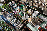 KADEEJEEN, BANGKOK, THAILAND, DECEMBER 2012:..Taling Chan floating Market in Thonburi area, Dec 2012...The Kadeejeen neighbourhood comprises six communities  Wat Kalaya, Kudeejeen, Wat Prayurawong, Wat Bupparaam, Kudee Khao and Roang Kraam...Ever since the Thonburi era (in the 17th Century), these historic neighbourhoods have maintained the diverse cultural heritage of three religions and four beliefs (Theravada Buddhism, Mahayana Buddhism, Christianity and Muslim) while coexisting in peaceful harmony...The neighbourhood is still characterised by Bangkok's traditional urbanism which is that of a fine-grained, religious establishment-centred urban structure with close-knit social cohesion. ©Giulio Di Sturco/Reportage by Getty Images.