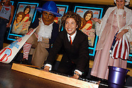 """Justin Guarini, American Idol runner-up and Doylestown native places his hand prints in cement at an advance screening of the film """"From Justin to Kelly"""" after being honored at the Regal Warrington Crossing 22 Theater June 13, 2003 in Warrington, Pennsylvania. Guarini stars in the Twentieth Century Fox film along with American Idol Kelly Clarkson. (Photo by William Thomas Cain/photodx.com)"""