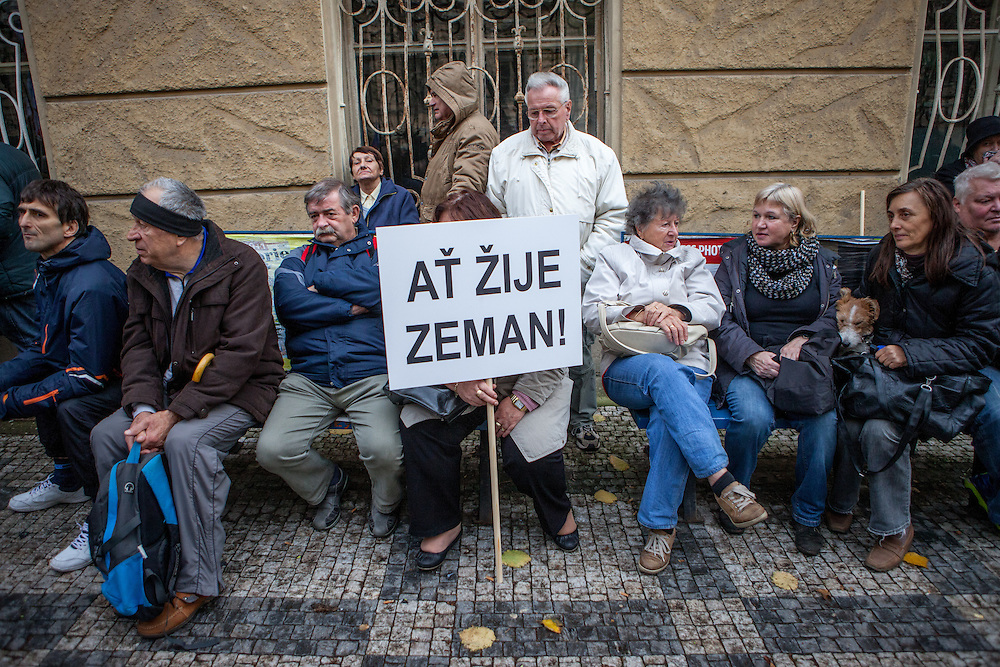 "Supporters of Czech President Milos Zeman holding a sign where is written ""Long live Zeman"" during an anti-Islam rally in Prague. Czech Republic celebrates that day the 26th anniversary of the Velvet Revolution which took place in 1989."