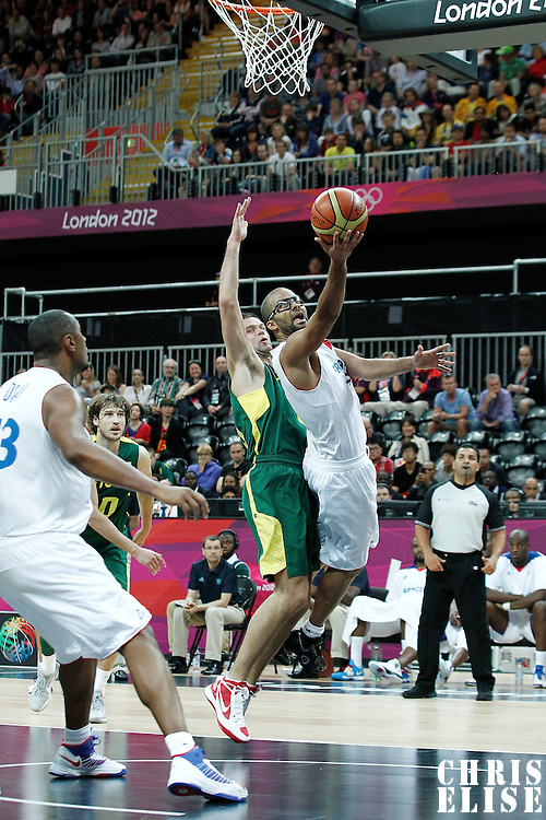 02 August 2012: Tony Parker of France goes for the layup past Lithuania Mantas Kalnietis during 82-74 Team France victory over Team Lithuania, during the men's basketball preliminary, at the Basketball Arena, in London, Great Britain.