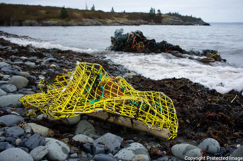 Lobster pots are often destroyed during large storms.  Here pots have been mangled and washed ashore.  These pots prove to be dangerous to the local Whale population in the Bay of Fundy