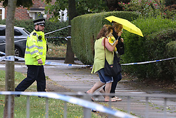 © Licensed to London News Pictures. 05/08/2019. London, UK. Two woman with flowers are seen on Waltheof Gardens in Tottenham, north London following a death of a woman in 46 Waltheof Gardens. Police were called around 10:45 am on 4 August 2019 where the body of an 89-year-old woman was found. According to the police one or more suspects gained entry to the woman's house between Saturday (3 August) evening and Sunday (4 August) morning. Photo credit: Dinendra Haria/LNP