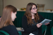 Meryl Diane Weaver, an Ohio University Graduate student studying Mathematics, listens to Tim Vicker remark about why she received a 2013 Graduate Associate Outstanding Teaching Award, Thursday, April 18, 2013. The awards ceremony was held in the Faculty Commons on the third floor of Alden Library.