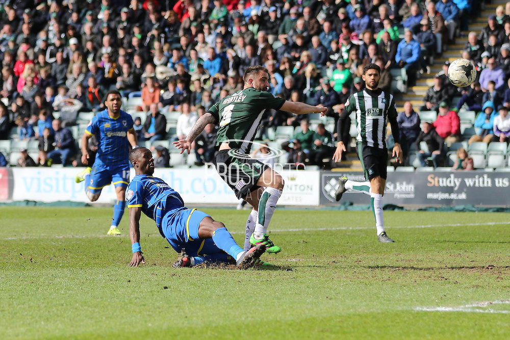 Ade Azeez forward for AFC Wimbledon (14) gets a shot on goal during the Sky Bet League 2 match between Plymouth Argyle and AFC Wimbledon at Home Park, Plymouth, England on 9 April 2016. Photo by Stuart Butcher.