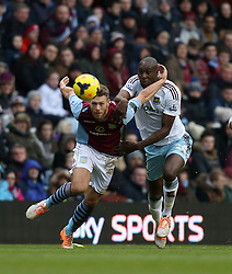 Aston Villa's Nathan Baker battles with West Ham United's Carlton Cole  - Photo mandatory by-line: Matt Bunn/JMP - Tel: Mobile: 07966 386802 08/02/2014 - SPORT - FOOTBALL - Birmingham - Villa Park - Aston Villa v West Ham United - Barclays Premier League