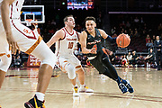 Pepperdine Waves guard Colbey Ross (4) drives past Southern California Trojans guard Quinton Adlesh (10) during an NCAA college basketball game, Tuesday, Nov. 19, 2019, in Los Angeles. USC defeated Pepperdine 91-84. (Jon Endow/Image of Sport)