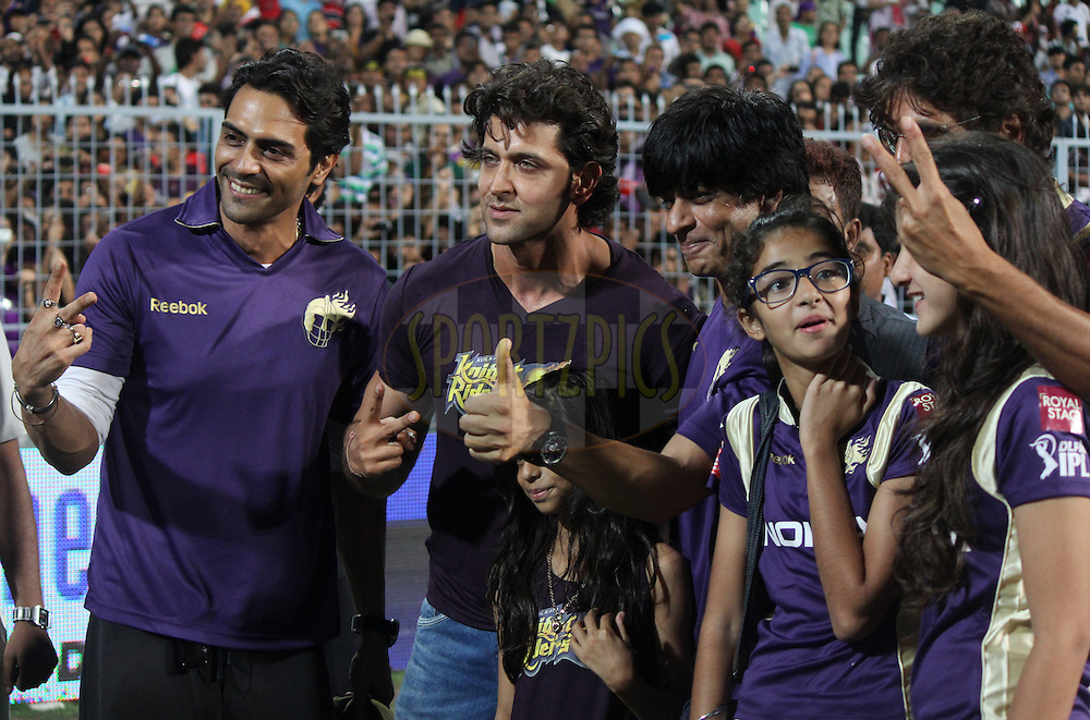 Shah Rukh Khan (2nd R), co-owner of Kolkata Knight Riders a long with Filmstar Hrithik Roshan pose after the match was stopped due to rainduring match 48 of the Indian Premier League ( IPL ) between the Kolkata Knight Riders and the Chennai Super Kings held at Eden Gardens Cricket Stadium in Kolkata, India on the 7th May 2011.Photo by Parth Sanyal/BCCI/SPORTZPICS.