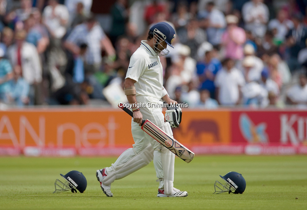 Sachin Tendulkar walks off after being out to James Anderson for twelve during the first npower Test Match between England and India at Lord's Cricket Ground, London.  Photo: Graham Morris (Tel: +44(0)20 8969 4192 Email: sales@cricketpix.com) 25/07/11