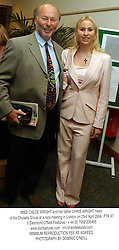 MISS CHLOE WRIGHT and her father CHRIS WRIGHT head of the Chysalis Group at a race meeting in London on 23rd April 2004. PTK 47