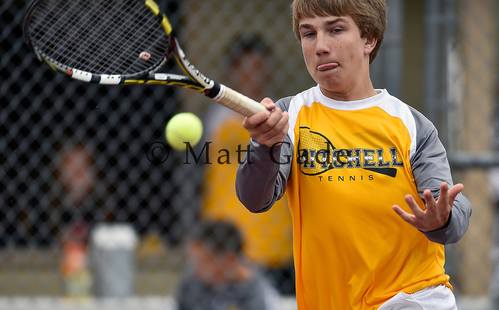 Mitchell's Adam Loes returns a shot during No. 1 doubles action with Jacob Dahme during a dual against Brookings on Tuesday at Hitchcock Park in Mitchell. (Matt Gade/Republic)