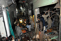 61017754<br /> People gather at the blast site in northwest Pakistan's Peshawar on Feb. 4, 2014. At least eight people were killed and 25 others injured on Tuesday evening as a blast hit a busy market in Peshawar, local media reported, Tuesday, 4th February 2014. Picture by  imago / i-Images<br /> UK ONLY