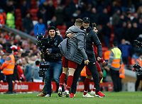 Football - 2018 / 2019 Premier League - Liverpool vs. Tottenham Hotspur<br /> Liverpool manager Jurgen Klopp and Jordan Henderson celebrate in front of the Kop after Liverpool take the three points, at Anfield.<br /> <br /> COLORSPORT/ALAN MARTIN