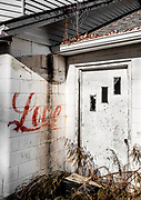 The message painted near the side entrance to this abandoned country store seems somewhat out of place. Or perhaps we just don't know the backstory.