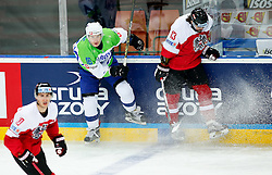 Ales Music of Slovenia and Michael Schiechl of Austria in action during ice hockey match between National Teams of Austria and Slovenia in 5th Round of 2016 IIHF Ice Hockey World Championship Division 1 - Group A, on April 29, 2016 in Spodek Arena, Katowice, Poland. Photo by Marek Piuyzs / Sportida