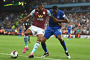 Aston Villa striker Wesley (9) battles for possession  with Everton defender Yerry Mina during the Premier League match between Aston Villa and Everton at Villa Park, Birmingham, England on 23 August 2019.