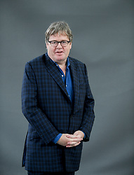 James Runcie appears at the 2019 Edinburgh International Book Festival.<br /> <br /> Journey back in time with The Road to Grantchester, James Runcie's superb prequel to his successful Grantchester Mysteries series. The future Archdeacon Sidney Chambers's young life is turned inside out when the Second World War tears through Britain's idyll, and he returns from Italy burdened with a secret. Runcie discusses his new book with Jane Fowler, in a perfect introduction for new readers and a deep dive for existing fans.<br /> <br /> © Dave Johnston / EEm