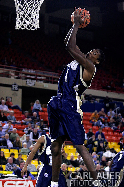 26 November 2005:  ORU senior forward, Larry Owens, grabs a rebound in the Oral Roberts University 62-54 victory over Monmouth University in the Great Alaska Shootout in Anchorage, Alaska..