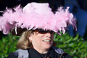 03 JANUARY 2009 -- PHOENIX, AZ:  Sharon Brackins (CQ) from Phoenix, wore a stylish pink hat during the annual Ft. McDowell Fiesta Bowl parade through Phoenix, AZ. More than 150,000 spectators line the parade routes which starts in north Phoenix and winds down Central Ave and 7th Street before ending in central Phoenix. More than 100 units march in the parade.  PHOTO BY JACK KURTZ