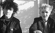 Paul and Lee sat outside in Hawthorne Road, UK, 1980s.