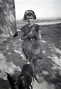 girl holding a little duck countryside 1950s