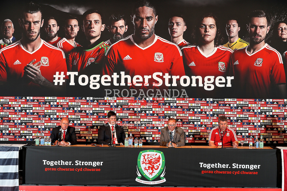 DINARD, FRANCE - Wednesday, June 8, 2016: Wales' head of pubic affairs Ian Gwyn Hughes Welsh Football Trust Chief Executive Neil Ward, Jean-Claude Hillion, President of the LBF and Wales assistant manager Osian Roberts during a press conference announce a partnership between the FAW Trust and the Ligue De Bretagne De Football at the media centre in Dinard during the UEFA Euro 2016 Championship. (Pic by David Rawcliffe/Propaganda)
