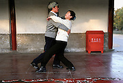 A couple amateur of tango dance in a park of the city of Beijing, China. A long time prohibited during political regime of Mao, tango is becamevery popular among the population.