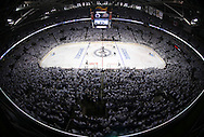 Opening face-off between the Winnipeg Jets' and Anaheim Ducks during the first period of game three NHL playoff hockey action in Winnipeg, Monday, April 20, 2015. Image taken with a fisheye lens.