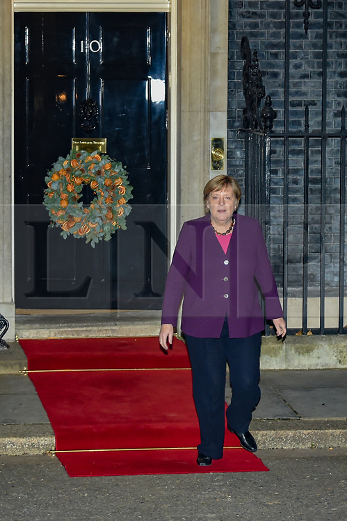 © Licensed to London News Pictures. 03/12/2019. London, UK. German Chancellor Angela Merkel departs Downing Street after meeting with Turkish President Recep Erdoğan and French President Emmanuel Macron. Allied leaders are in London for a NATO summit. The summit also marks NATO's 70th anniversary. Photo credit: Peter Manning/LNP
