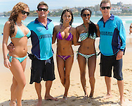 SYDNEY, AUSTRALIA, FEBRUARY 25, 2011: UFC octagon girls Brittneyt Palmer, Arianny Celeste and Chandella powell pose with lifeguards on Bondi Beach in Sydney, Australia on February 25, 2011.