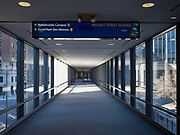 """13 MARCH 2020 - DES MOINES, IOWA: An empty skywalk in downtown Des Moines leading to the Nationwide Insurance campus. Downtown Des Moines is nearly deserted as many of employers are implementing work at home rules. The Governor of Iowa announced Friday that 17 people in Iowa have tested positive for the Novel Coronavirus. Of those, 15 people were exposed on the same cruise in Egypt, the others were exposed through travel but were not on the same cruise. The Governor said there has not yet been any """"community spread"""" in Iowa. All of the Iowans who have tested positive are in self quarantine. Across Iowa, municipalities and businesses are taking steps to implement """"social distancing."""" Most of the colleges in Iowa have announced that they will remain closed after their spring breaks and that classes will move to online only, after spring break. Many businesses in Des Moines, including Nationwide Insurance and EMC Insurance, have announced plans to have their employees to telecommute. The mayor of Des Moines has urged event planners to consider canceling large events.     PHOTO BY JACK KURTZ"""