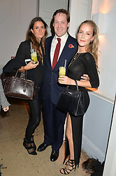Left to right, ROSANNA CLARENCE-SMITH, the MARQUESS OF BOWMONT & CESSFORD and HUM FLEMING at the Tatler Little Black Book Party held at Home House Private Member's Club, Portman Square, London supported by CARAT on 6th November 2014.
