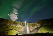 Since I was camping near Seljalandsfoss, I went over to get a few shots of the aurora above the falls. I wished I could have turned off the spotlights, since they were a bit too bright. The moon was positioned at the top of the falls.