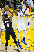 Golden State Warriors forward Kevin Durant (35) attempts to block a shot by Portland Trail Blazers forward Maurice Harkless (4) at Oracle Arena in Oakland, Calif., on October 21, 2016. (Stan Olszewski/Special to S.F. Examiner)