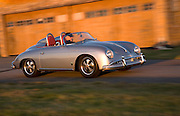 Image of a custom silver sports car in motion, 1958 Porsche 356 Speedster in Washington state, Pacific Northwest, model and property released