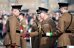 © Licensed to London News Pictures. 01/03/2012. Hounslow, UK.  HRH  Prince Charles Presenting leeks to 1st Battalion The Welsh Guards at Cavalry Barracks,  Hounslow, London on St David's Day, March 1st, 2012.  Two-thirds of the Battalion's 600 soldiers are due to be deployed to Afghanistan in the next two weeks. Photo credit : Ben Cawthra/LNP