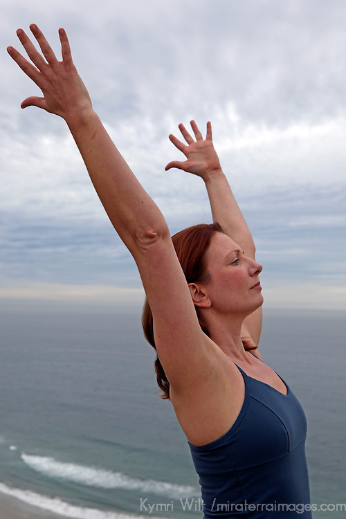 USA, California. Healthy natural woman, 30's to 40's, in yoga posture outdoors.