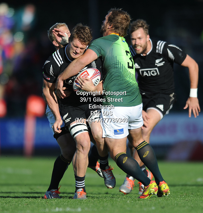 Scott Curry - New Zealand runs into a crunching tackle from Frankie Horne - South Africa.<br />