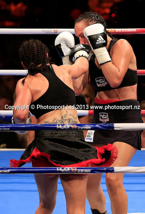 Daniella Smith and Blencowe in action. Boxing, Hyrd8 Zero Explosion, Fight Night, Trusts Arena, Auckland, Thursday 13th June 2013. Photo: Shane Wenzlick / Photosport.co.nz